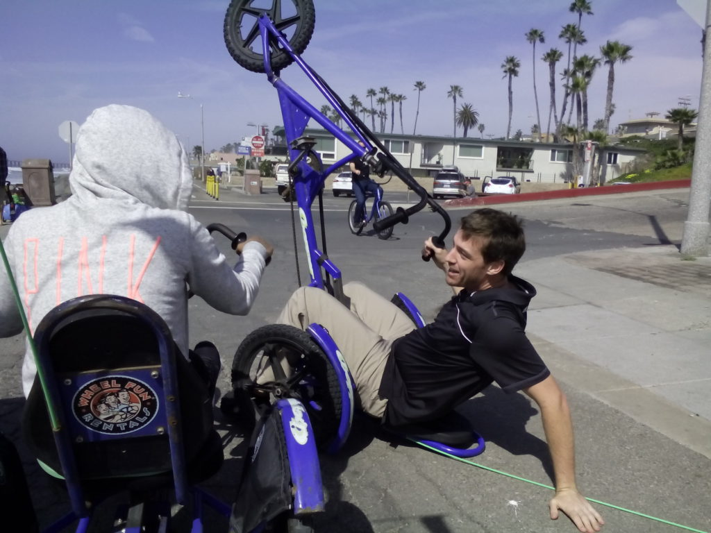 Photo of HireAHelper CEO Mike Glanz Pulling a Wheelie